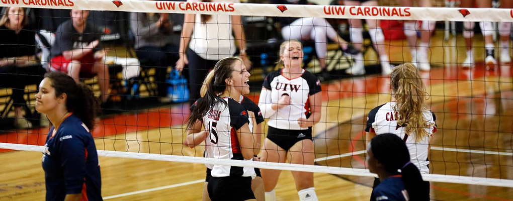 UIW women's volleyball members celebrate a point on the court