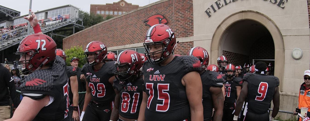The UIW Football team walks out of the field house prepared to take the field