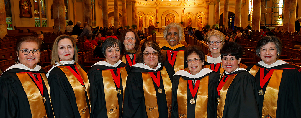Members of the Incarnate Word College Class of 1969 pose for a photo in Our Lady's Chapel