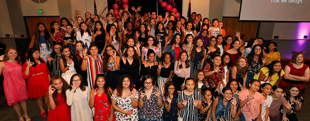 198 girls from local schools pose for a photo at the miniGEMS banquet