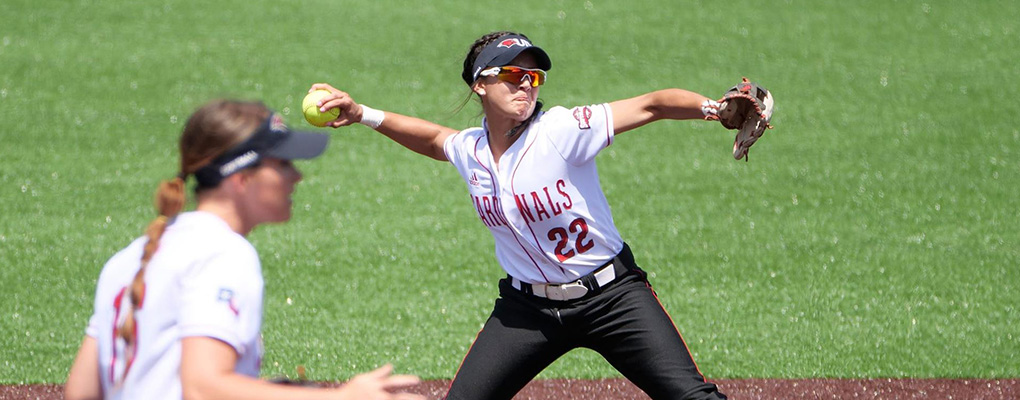 UIW softball player throws pitch