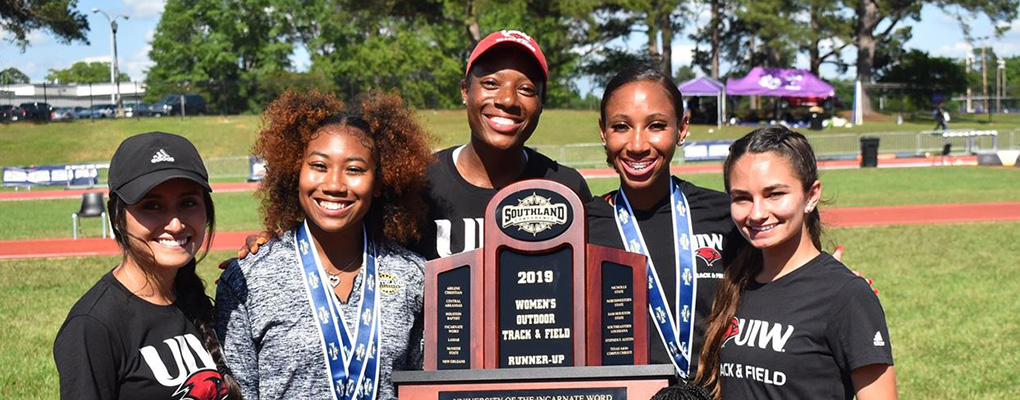UIW women's track wins runner-up and holds trophy