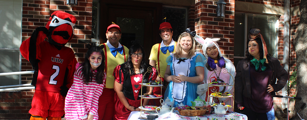 UIW employees dressed as characters from Alice in Wonderland pose for a photo
